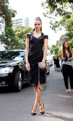 Shanina Shaik wears Dion Lee dress and Chanel bag.